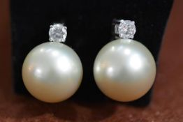 A pair of large 18ct gold cultured pearl and diamond earrings, each pearl approximately 14mm in