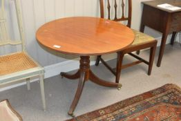 An early 19th century mahogany tripod table, the circular top with reeded edge on a baluster