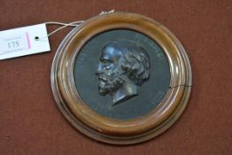 A French Bois Durci portrait roundel, 19th century, depicting Garibaldi, in a wooden frame.