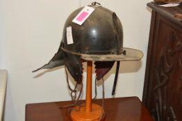 "A black japanned trooper's helmet of Cromwellian ""lobster tail"" type, with one piece skull,"