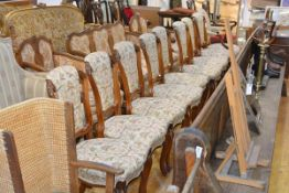 A set of eight 19th century rosewood dining chairs, each with leaf-carved and part-upholstered