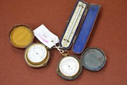 Two early 20th century pocket barometers, both in gilt metal, one marked Bryson Edinburgh in a