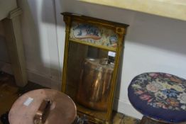 A small early 19th century giltwood pier mirror, with verre eglomise panel decorated with a courting