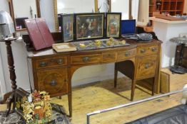 An Edwardian crossbanded mahogany sideboard in George III style, the rectangular galleried top