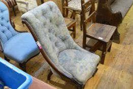 A mid-Victorian rosewood framed buttoned scroll-back lady's armchair, raised on cabriole legs moving