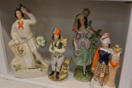 A group of four 19th century Staffordshire figures of characters with birds, including a