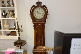 A mid-19th century Scottish mahogany drumhead longcase clock, the hood with foliate carved
