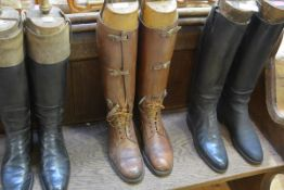 A pair of early 20th century gentleman's brown leather lacing boots, in period wooden boot trees