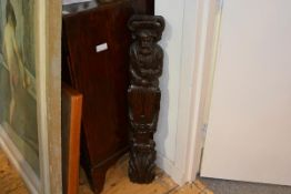 A carved oak term in 16th century style, late 19th century, with scroll carved capital and leaf-