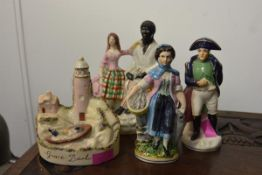 A group of 19th century Staffordshire comprising: Eva and Uncle Tom (repaired); Napoleon; a