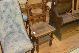 A 19th century oak metamoprhic chair / library step, in the Gothic taste, with pierced splats and