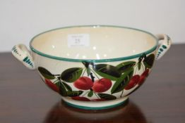 A Wemyss Ware fruit bowl, twin handled, painted with cherries, painted marks including retailer