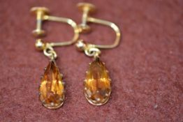 A pair of 9ct gold pear shaped citrine drop earrings with screw fastenings, each drop approx. 1.
