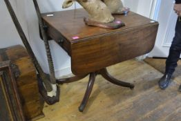 A 19th century mahogany sofa table, with twin drop leaves over a frieze drawer opposed by a dummy,