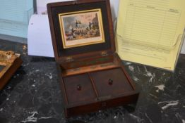 A mahogany travelling writing box, first half of the 19th century, the cover inset with a mid-19th