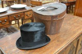 A black silk top hat, Tress & Co., London for Jenners of Edinburgh, in its original leather case.