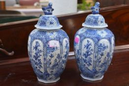 A pair of Boch Freres Delft vases and covers, late 19th century, in the Chinese taste, each of