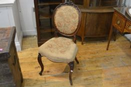 A 19th century walnut framed side chair, the oval padded back with floral-carved crest, above a