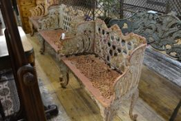 A pair of cast iron two seater garden benches (weathered) in the Coalbrookdale style, each cast with