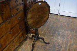 A late George III mahogany piecrust tilt-top tripod table, the (possibly associated) top above a