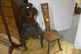 A 19th century mahogany hall chair, with shield-carved back; together with a pokerwork spinning