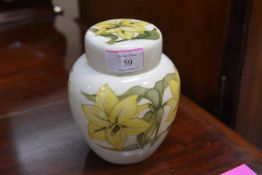 A Moorcroft jar and cover, in the Bermuda Lily pattern, yellow flowers against a cream ground,
