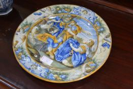 An Italian Istoriato maiolica charger, the well painted with armoured figures within a border