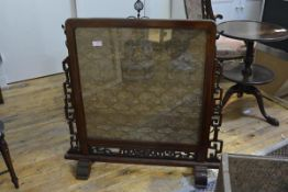 A Chinese rosewood framed needlework-inset firescreen, early 20th century, the silk needlework panel