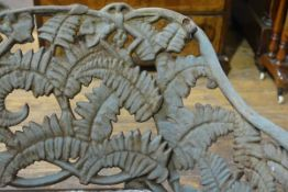 A cast iron garden bench in the Coalbrookdale style, weathered, the back and sides cast with