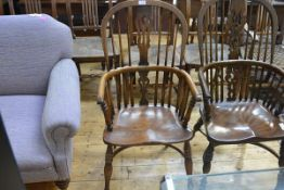 An oak and elm Windsor armchair in 19th century style, with hoop back, dished seat and turned legs