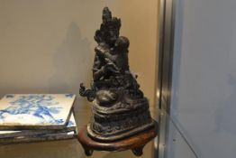 A bronze figure of a seated Buddha, probably Tibetan, in the yab yum position with a female, on an