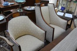 A pair of Edwardian inlaid mahogany gentleman's and lady's armchairs each scroll carved crest rail