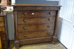 "A Victorian mahogany ""Scotch"" chest of drawers, the overhanging rectangular top with two frieze"