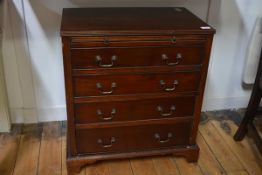 A small George III mahogany chest of drawers, the rectangular top with reeded edge above a