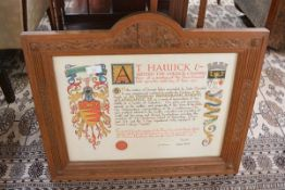 An illuminated presentation award of the Freedom of the Burgh of Hawick, with wax seal, in a