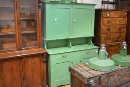 A 19th century green-painted dresser, the superstructure with moulded cornice above a pair of