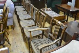 A set of seven early 19th century oak and elm country dining chairs, including one carver, each with