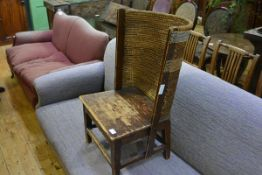 A child's Orkney chair, the stained pine frame with rush back and raised on tapering legs joined