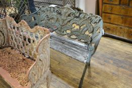 A cast iron garden bench in the Coalbrookdale style, weathered, the back and sides cast with ferns