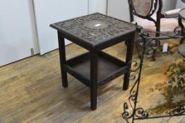 An unusual carved oak occasional table, early 20th century, the square top carved in high relief