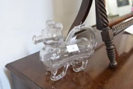 "A novelty glass ""Gin Pig"", c. 1900, of moulded and blown glass, the tail formed as a handle (lacking"