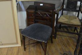 A set of four Regency mahogany dining chairs, each with tablet crest above pierced horizontal splat,
