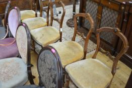 A set of five Victorian walnut side chairs, each with shaped balloon back, stuffed over seat and