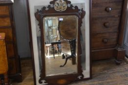 A George III style parcel gilt and mahogany fretwork mirror, the crest with stylised leaf over an