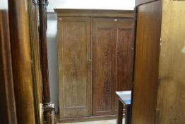 A 19th century pitch pine housekeeper's cupboard, with moulded cornice above a central panel opening
