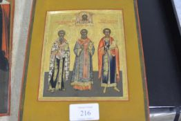 Russian School, late 19th century, an icon of three saints, named, portrayed beneath a vignette of