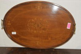 An inlaid mahogany tea tray in the Edwardian taste, oval, with scalloped gallery and brass