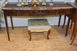A George III style mahogany bowfronted serving table, fitted with two frieze drawers mounted to