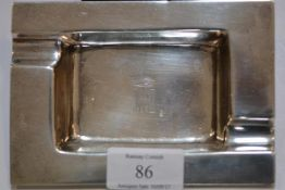 A sterling silver ashtray in the Art Deco taste, stamped 925, engraved with a monogram beneath a