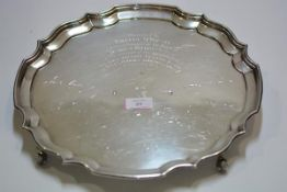 A silver footed salver in the Georgian taste, Birmingham 1978, circular, with scalloped rim and